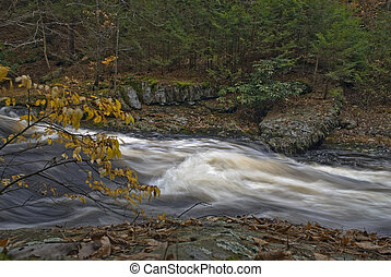 A time exposure of fast moving water of Bushkill Creek in the Pocono Mountains of Pennsylvania.