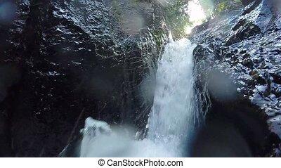 Raging clean fresh mountain river flowing between rocks in...
