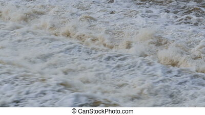 Raging flowing water after dam with sound