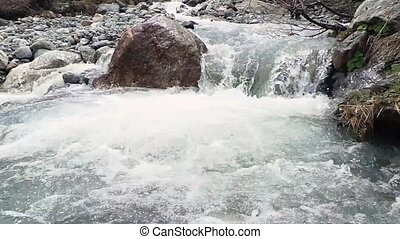 Raging Mountain river. Wildness of clean, clear water in the mountain river.