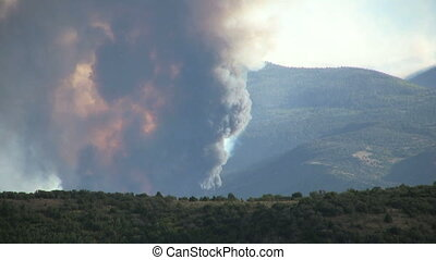 Raging Mountain Wildfire - a mountain wildfire raging in the...