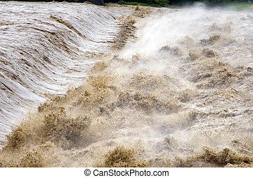 Raging River - A wild raging river after excessive rainfall
