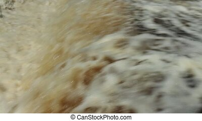 raging waterfall - continuous flow of a raging waterfall...