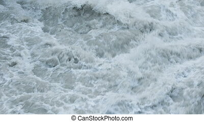Raging waters of Hraunfossar waterfall in Iceland closeup