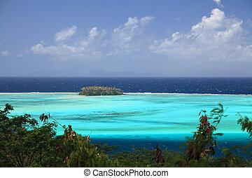 Raiatea Lagoon with small Motu in French Polynesia from above. Dreamlike colors.