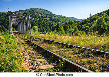 rail metal bridge in mountains - rail metal bridge in the...