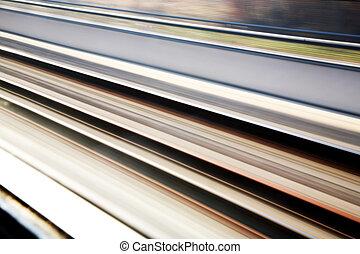 a blur of rail-road tracks