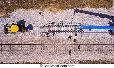 Rail tracks maintenance process. Repairing railway.