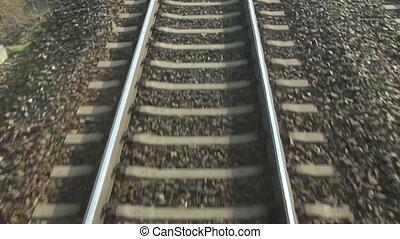 Rail - train passing through countryside, moving railroad...