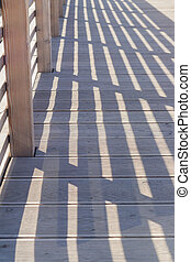 Railing Shadows on the wooden bridge for background.