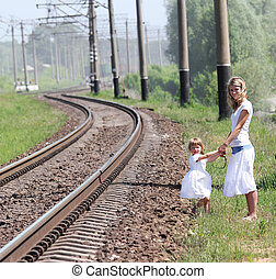 railroad and a mother with her daughter