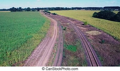 Railroad between fields - Long railroad between two large...