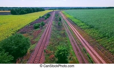 Railroad between fields - Railroad between two large fields