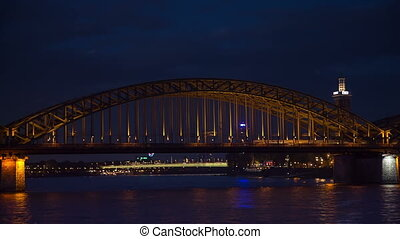 Railroad bridge in Cologne at night, timelapse