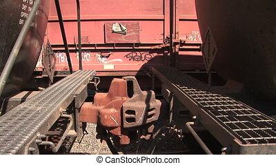 Railroad car coupler