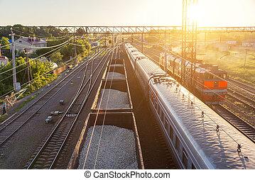 railroad cars at sunset