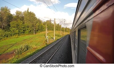 Railroad cars outside train ride on rails near the forest railway. slow motion video. The train with the carriages moves next to the forest. concept railroad train cars lifestyle and train journey travel