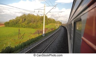 Railroad cars outside train ride on rails near the forest railway. slow motion video. The train with the carriages moves next to the forest. concept railroad train cars and lifestyle train journey travel
