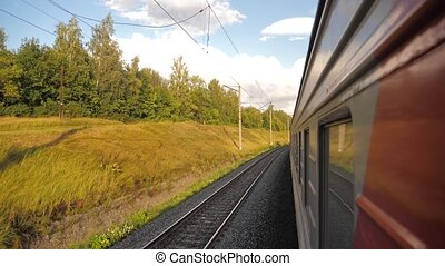 Railroad cars outside train ride on rails near the forest railway. slow motion video. The train with the carriages moves next to the forest. concept railroad train lifestyle cars and train journey travel