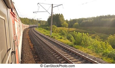 Railroad cars train ride on rails near the forest railway...