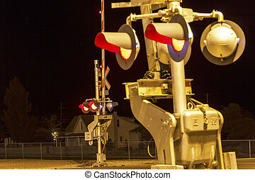 Railroad crossing by night with sign in kingman