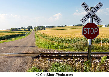 Railroad crossing - Roalroad crossing and stop sign in...