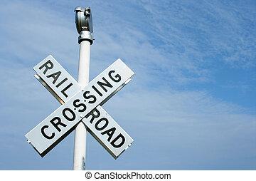 Railroad Crossing Si - Railroad crossing sign against blue...