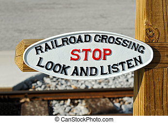 Railroad Crossing Sign Warning to Stop, Look and Listen