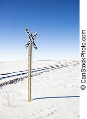Railroad crossing sign. - Railroad crossing sign by tracks...