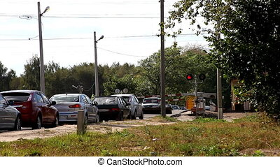 Railroad crossing with cars