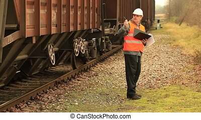 Railroad employee near  the wagons