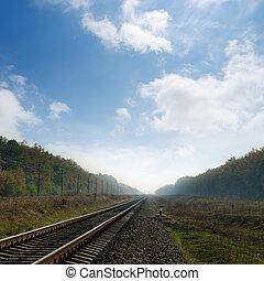 railroad in fog to horizon
