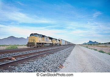 Railroad locomotive travelling across Arizona