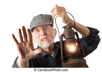 Railroad man holding lantern - Apprehensive railroad man...