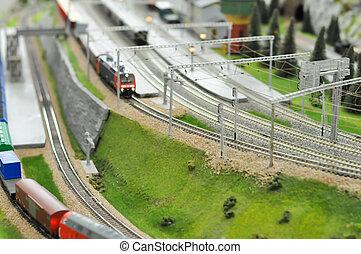 Railroad maquette with colorful trains