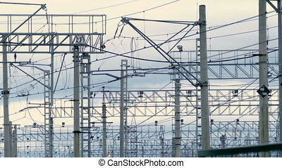 Railroad railway overhead power lines against sky. Contact...