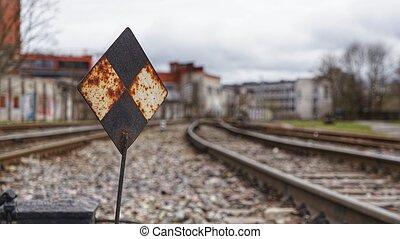 Railroad Sign on Railway Tracks - Railroad Sign between...