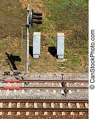 Railroad signal - Two pairs of rails and a signal post