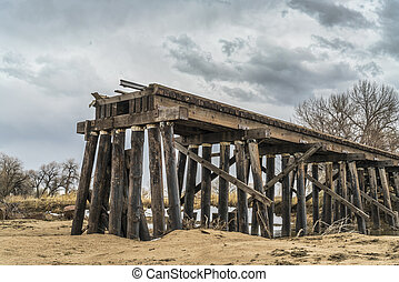 railroad timber trestle destroyed by river flooding - St ...