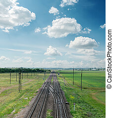 railroad to horizon and clouds on sky