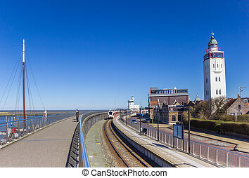 Railroad track and lighthouse in the harbor of Harlingen, Netherlands