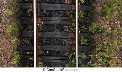 Railroad track close up. Train railway tracks in summer. View from above.
