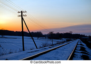 Railroad track during sunny winter morning