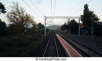 Railroad track from the rear of a high speed train in...