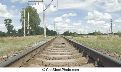 Railroad track in perspective on blue sky