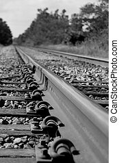 Railroad Track - Railroad track in black and white showing...