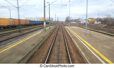 Railroad track running through european coutry landscapes