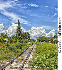 Railroad track - Image of a railroad track with a dramatic...
