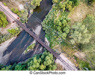 railroad tracks and river aerial view