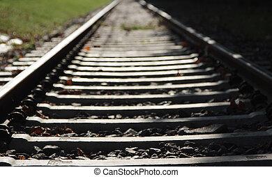 Railroad tracks, focus on foreground.